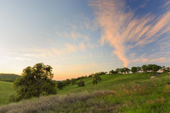 Country side. At sunset time with beautiful sky and clouds Stock Photography