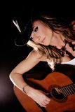 Country Singer. Beautiful Woman in Country Western Fashion Playing A Guitar Stock Images
