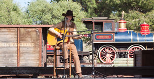 Country singer appeares against railway station stock photography