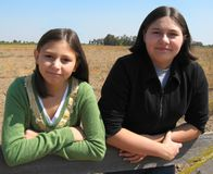 Country Sisters. Sisters by the country fence Stock Photos