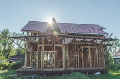On a country site construction of timber frame wooden house royalty free stock images
