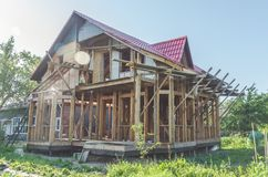 On a country site construction of timber frame wooden house stock photo