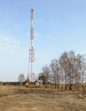Country spring landscape with cellular tower Stock Photo