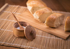 Country still life, white bread, milk jug and spices. Country still life. Pitcher of milk on a wooden table Stock Image