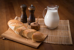 Country still life, white bread, milk jug and spices Stock Photo