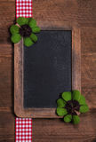 Country style background with an old blackboard, shamrock and re Stock Photo