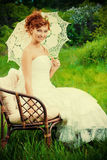 Country style. Beautiful smiling bride with chaming red hair. Wedding dress and accessories. Wedding decoration Royalty Free Stock Photo