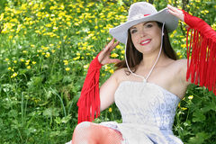 Country style bride. The young bride on a meadow with yellow colours Royalty Free Stock Photography