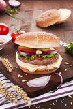 Country style cheeseburger. Royalty Free Stock Photos