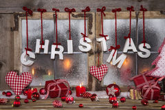 Country style christmas decoration in red, white and wood on an Stock Photography