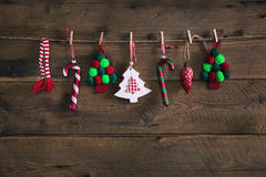 Country style christmas handmade decoration hanging on an old ru Stock Photography