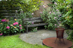 Country-style garden with bench Royalty Free Stock Photo