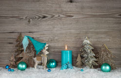 Country style greeting card for christmas with candle and reinde. Country style greeting card for christmas with candle and elk in turquoise and brown colors Stock Images