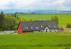 Country style house with green field. Country style house in the large green field Stock Images
