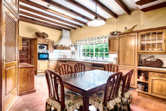 Country style kitchen with dining room Stock Photography