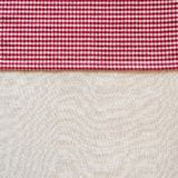 Country Style Red and White Checked Cloth Napkin along side of Off White Linen Tablecloth as blank Background with room or space f
