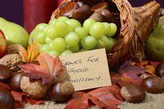Country style rustic Thanksgiving table setting. Closeup on cornucopia with Thanks for Good Company message Royalty Free Stock Images