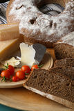 Country Style Rye Bread, Parmesan Cheese And Cherry Tomatoes Royalty Free Stock Image
