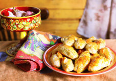 Country style still life with  garlic, pies , table cloth and ki Royalty Free Stock Images