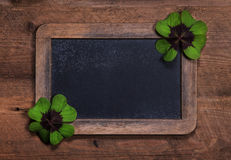 Country style wooden background or billboard with two four-leaf. Rustic country style wooden background or billboard with two four-leaf clovers Stock Photo
