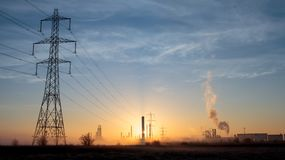 Morning Pollution 4. Country sunrise scene with industrial buildings, pollution and fog. Greenpeace and Earth day. Plastics production and smoke. Oil producing royalty free stock photos