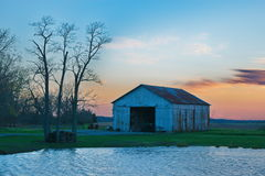 Country Sunset. Farm in the midwest, Illinois at sunset with trees and pond in the Spring Stock Photography