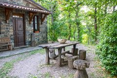 Country table. Wooden table in the backyard of a country house stock photography