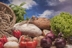 Country theme with vegetables and baking goods with sky background Stock Photos