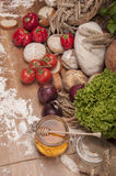 Country theme with vegetables and baking goods with sky background Royalty Free Stock Photos