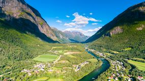 Village, river and mountains natural landscape aerial drone photography Norway in summer. Stock Photography