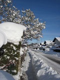 Country town, the street covered by snow Royalty Free Stock Image