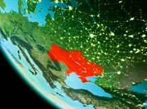 Ukraine in red in the evening. Country of Ukraine in red on planet Earth in the evening. 3D illustration. Elements of this image furnished by NASA Stock Photography