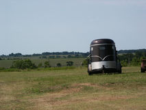 Country View. A horse trailer parked in a pasture out in the country Royalty Free Stock Photography