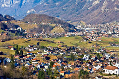 Country village. Aerial view of a village with fields and mountains. Switzerland Stock Photos
