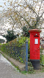 Country village postbox. Photo of a kent country red pillarbox underneath a springtime cherry blossom tree.photo taken 31st march 2017 royalty free stock images