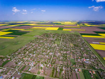 Country village surounded by crop fields in the spring Stock Images