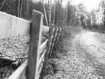 Country walk #1. Fence next to a rambling path in winter stock photography