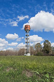 Country water tower view. Vertical shot of country water tower Stock Photos