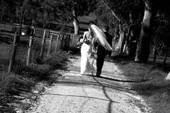 Country Wedding II. Bride and Groom take a walk down a country track on their wedding day Stock Photos