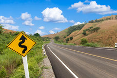 Country winding road blue sky Royalty Free Stock Images