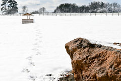 A Country Winter Wonderland. A water pump in an empty snow covered field in East Texas Royalty Free Stock Photos