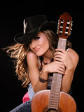 Country Woman. Beautiful Woman in Country Westren Fashion Holing A Guitar Stock Photography