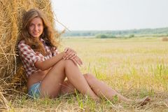 Country woman in a barn Stock Photo