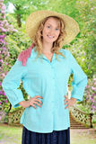 Country woman in a garden Stock Photo