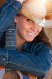 Country Woman Holding Guitar Stock Photography