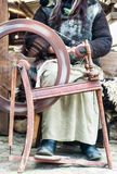 Country woman on spinning wheel Royalty Free Stock Images