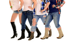 Country Women Line Dance. Four Sets of ladies country western legs in cowboy boots line dancing royalty free stock image