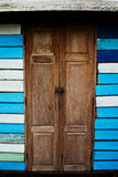 Country Wooden Door. Blue house with country style wooden door Stock Photo