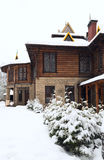 Country wooden house and winter fir trees Royalty Free Stock Images