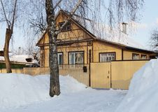 Country wooden house, winter time royalty free stock photography